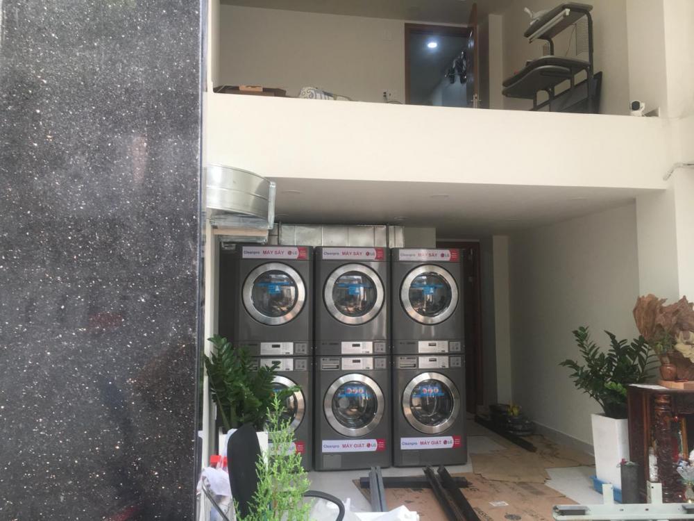 Mở cửa hàng giặt là gia đình như thế nào ?